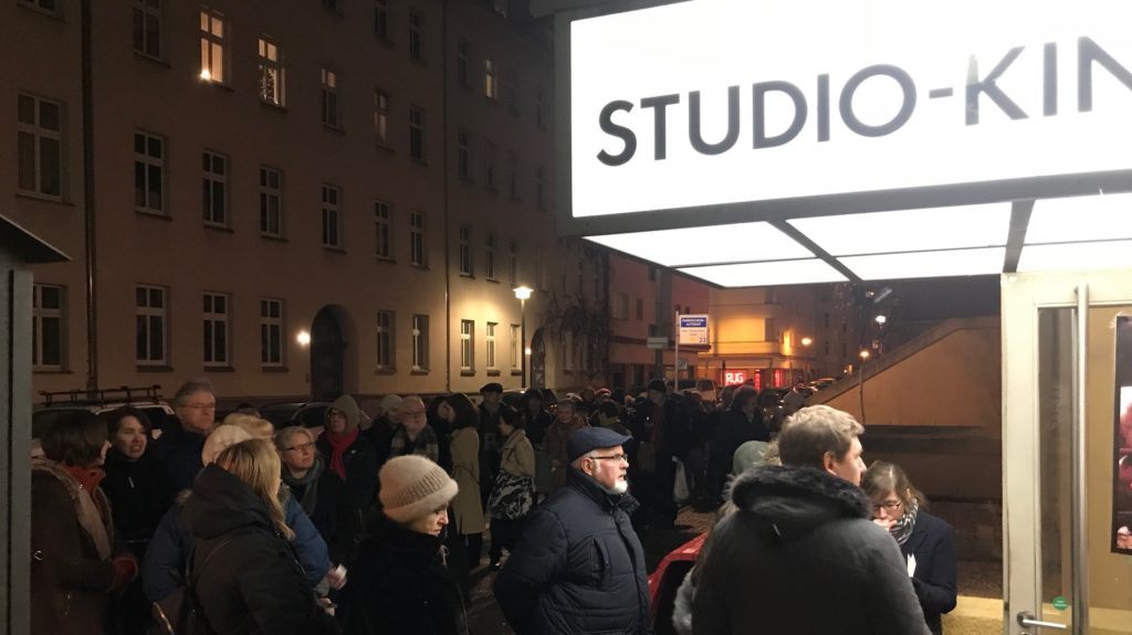 A queue of people in front of a BABYLON Cinema in Berlin