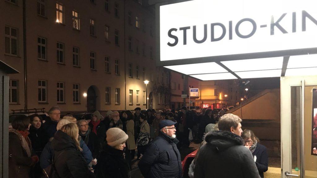 A queue of people in front of a BABYLON Cinema in Berlin