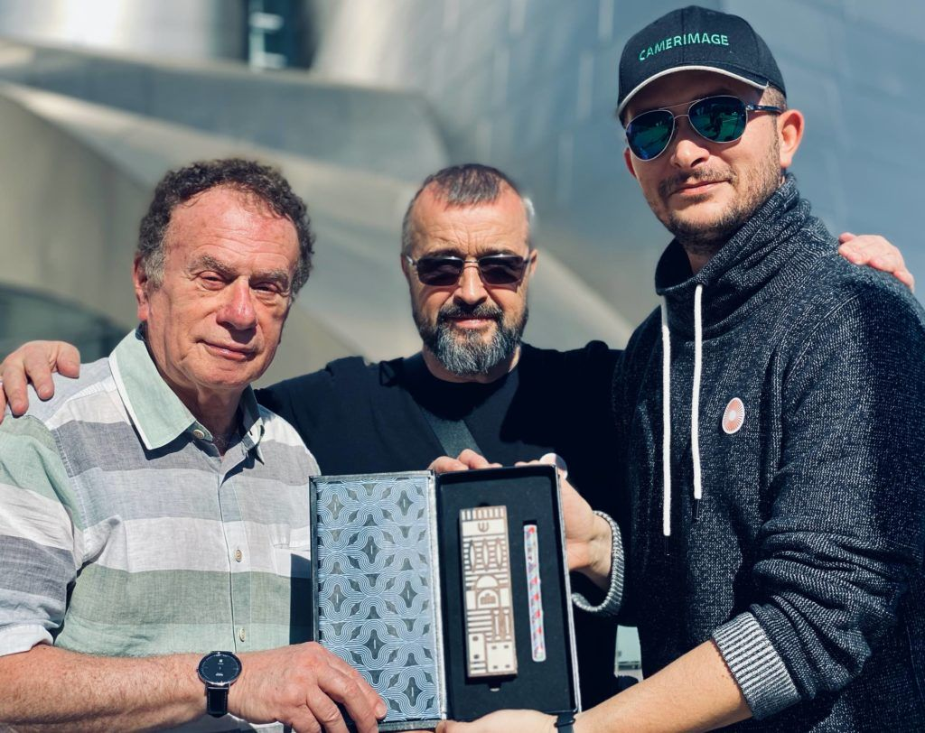 Directors and the protagonist of the movie hold the Best Polish Film Award of the Jewish Motiffs International Film Festival in front of Disney Concert Hall